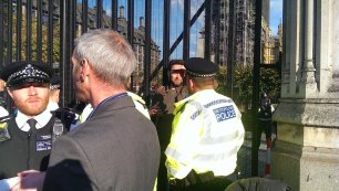 Nick Cooper attached himself to a gate outside parliament