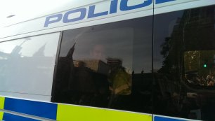 Nick Cooper in a police van