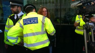 Ruth Jarman is led away by police