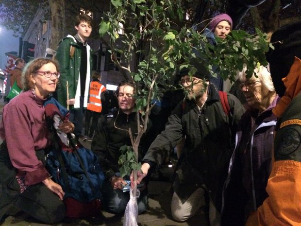 Ruth Jarman planting a tree with other CCA members before being arrested