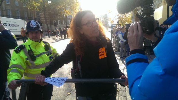Ruth Jarman superglued to fencing outside Downing Street.jpg