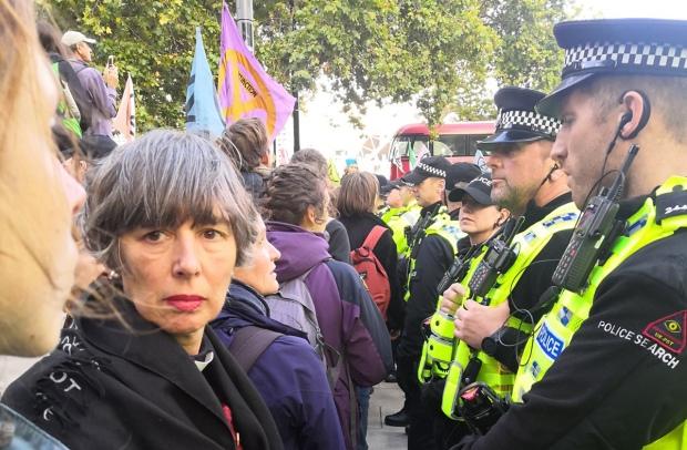 Helen facing the police